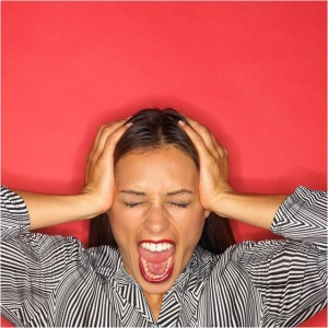 Woman holding head screaming